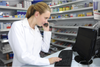female pharmacist holding a phone